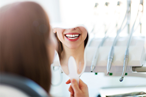 womans smile in reflection of mirror